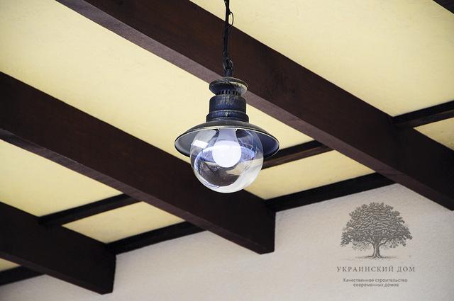 Канадский дом под ключ из сип панелей в Запорожье - готовый дом - освещение на веранде